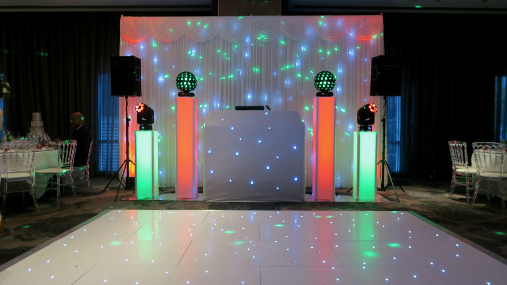 Radisson Docklands Premier Set Up, White Starlit Booth & Backdrop, White LED Dance Floor, Orange & Green Uplighting